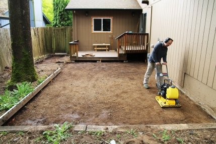 A plate compactor is a must-have rental. It vibrates and packs the soil so there won't be any soft spots that settle later.