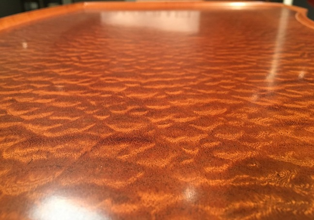 the-top-of-the-tray-table-is-a-sea-of-sapele